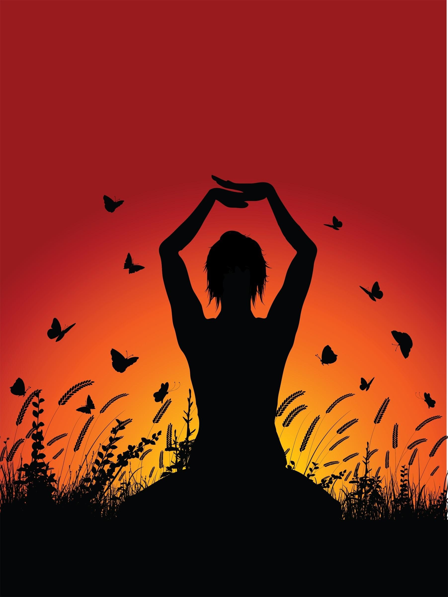 female_in_yoga_pose_against_sunset_sky_1003